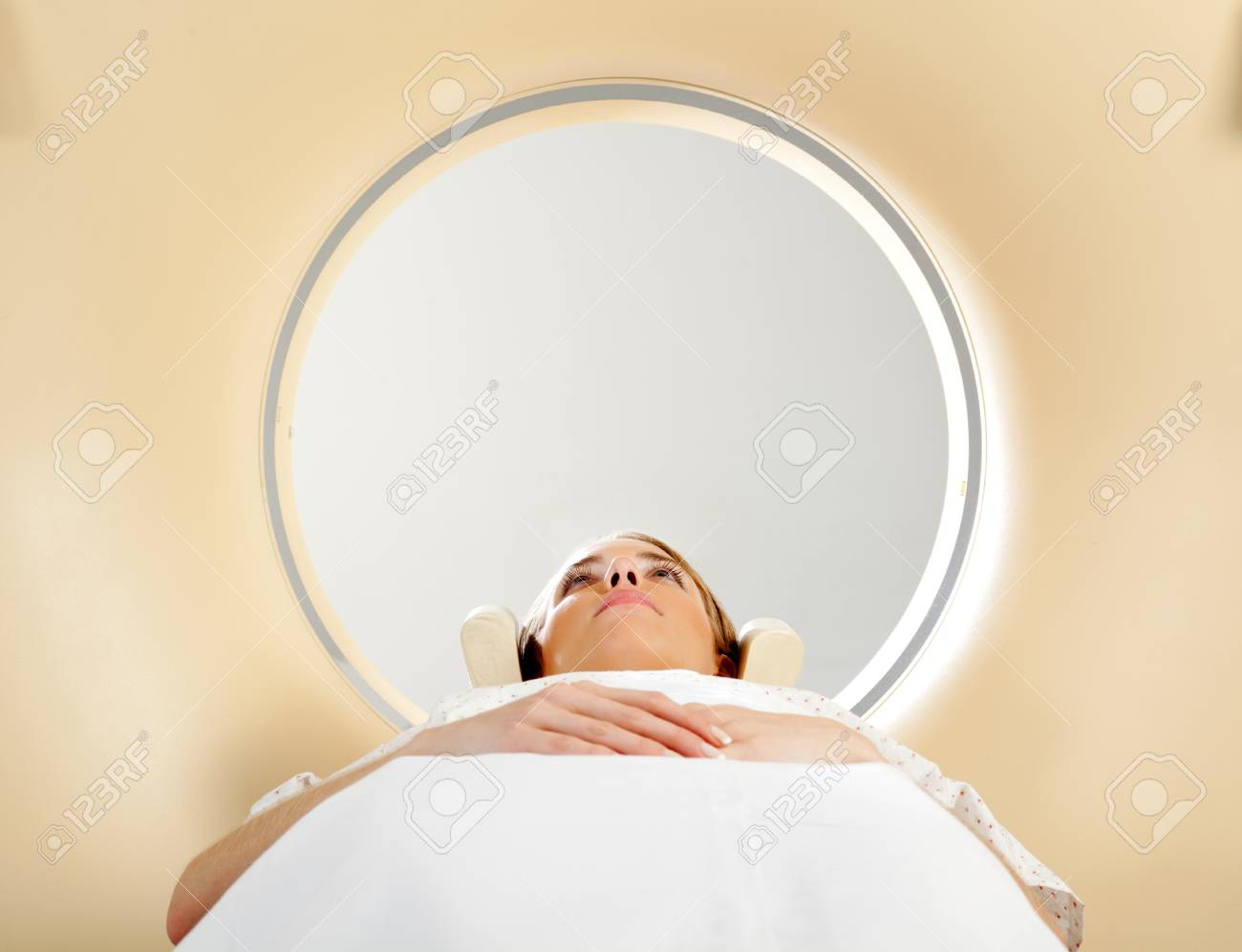 A woman laying down with eyes open having a CT scan Stock Photo - 9323190
