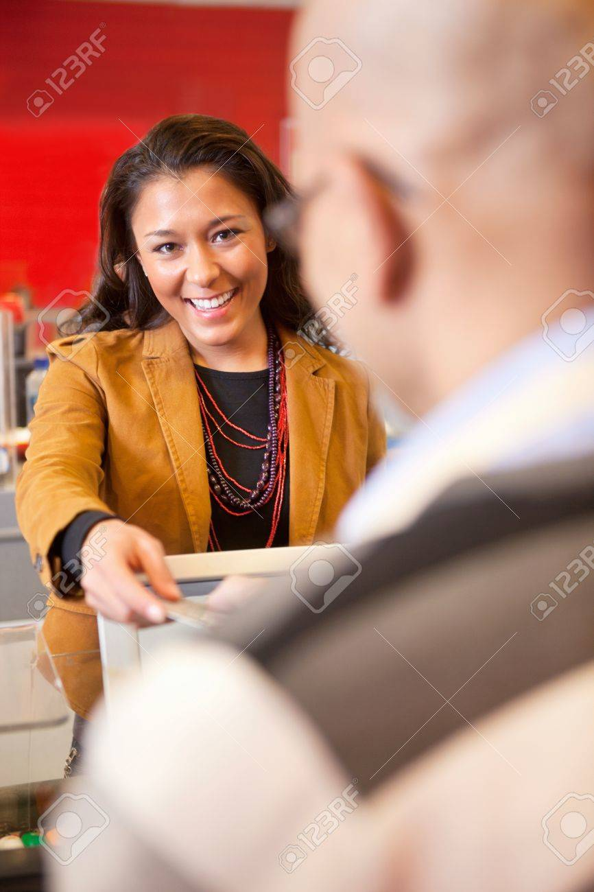 Passing over credit card to shop assistant after shopping Stock Photo - 9470683