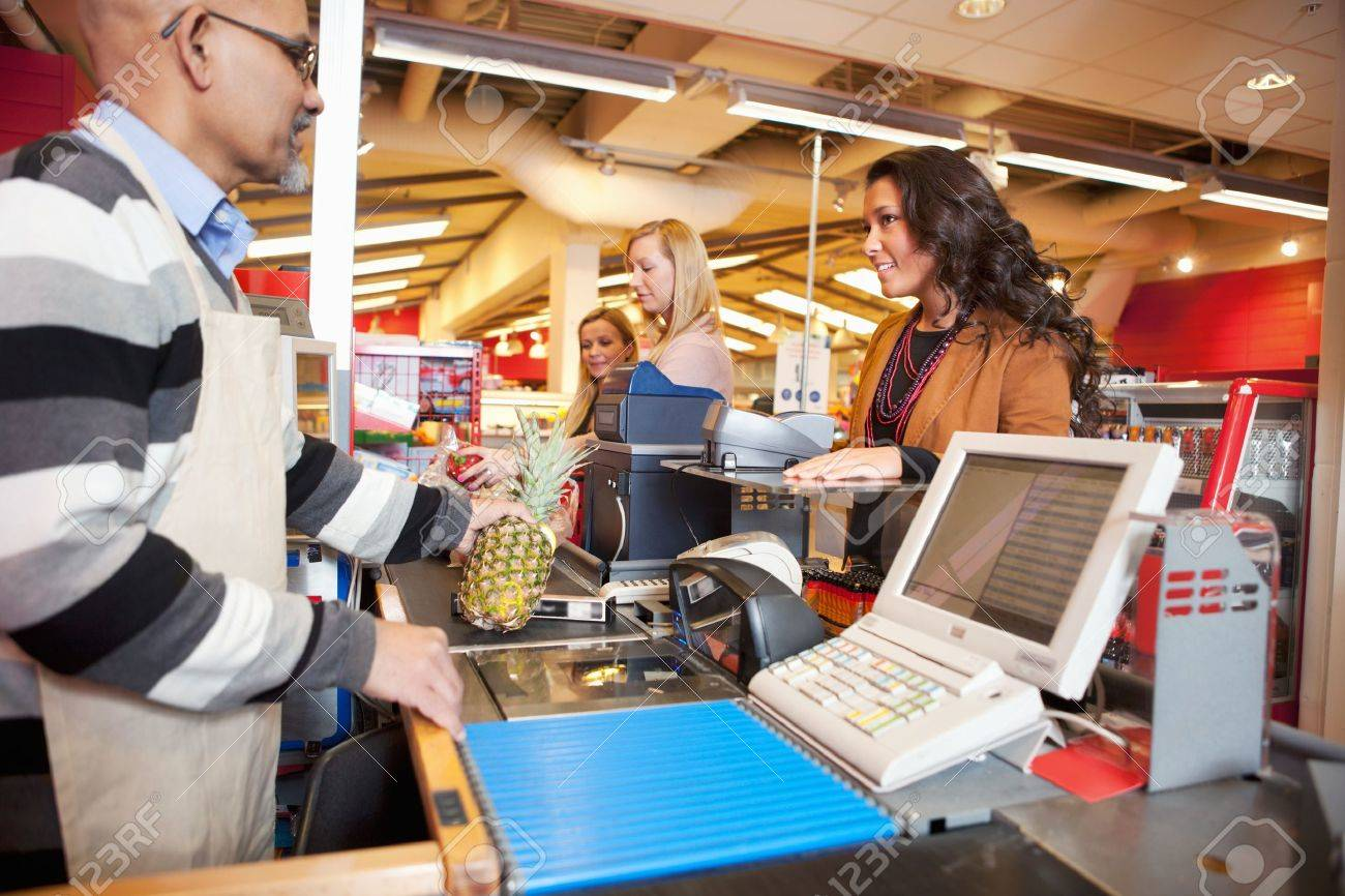 Shop assistant with customer in supermarket Stock Photo - 9470715