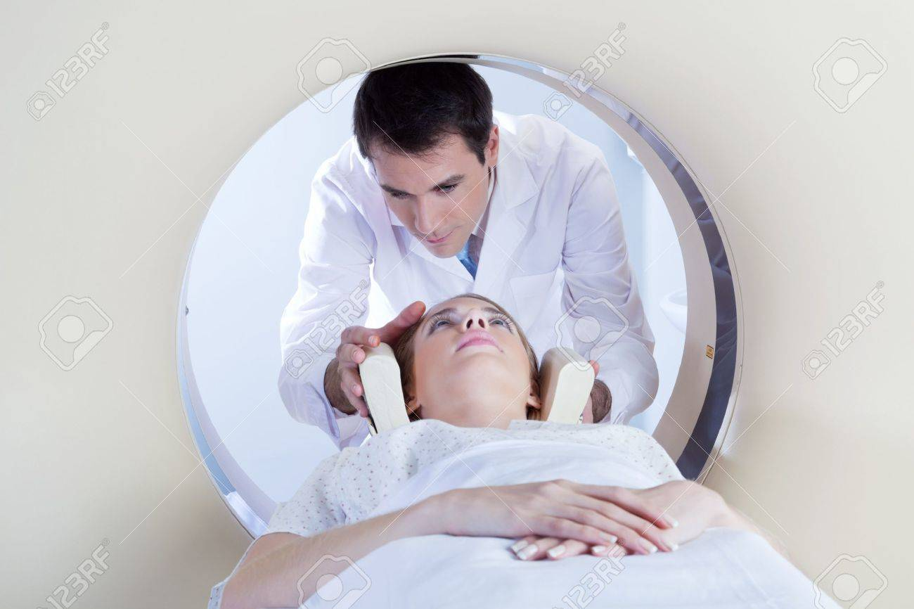 Technologist preparing the patient for a CT scan in hospital Stock Photo - 9683378