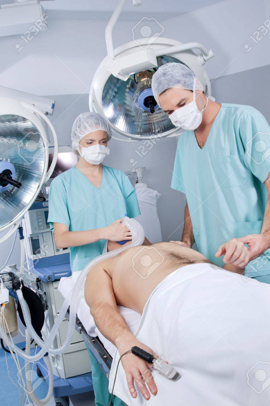 Nurse and doctor preparing the patient for an operation in a hospital Stock Photo - 9887238