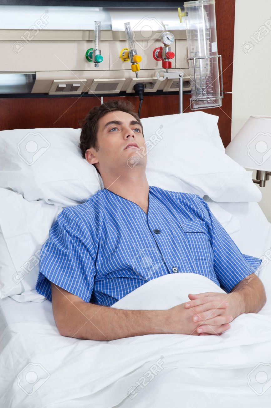An severe male patient at hospital bed Stock Photo - 9887506