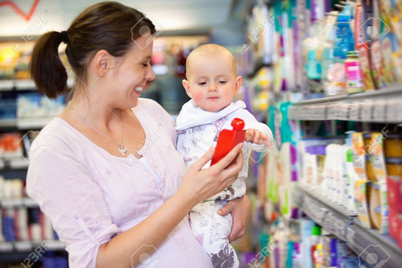 Cheerful mother playing with baby and spending time in shopping store Stock Photo - 9886871