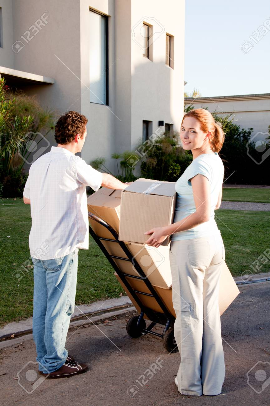 A happy moving couple with boxes on a trolly Stock Photo - 9886963