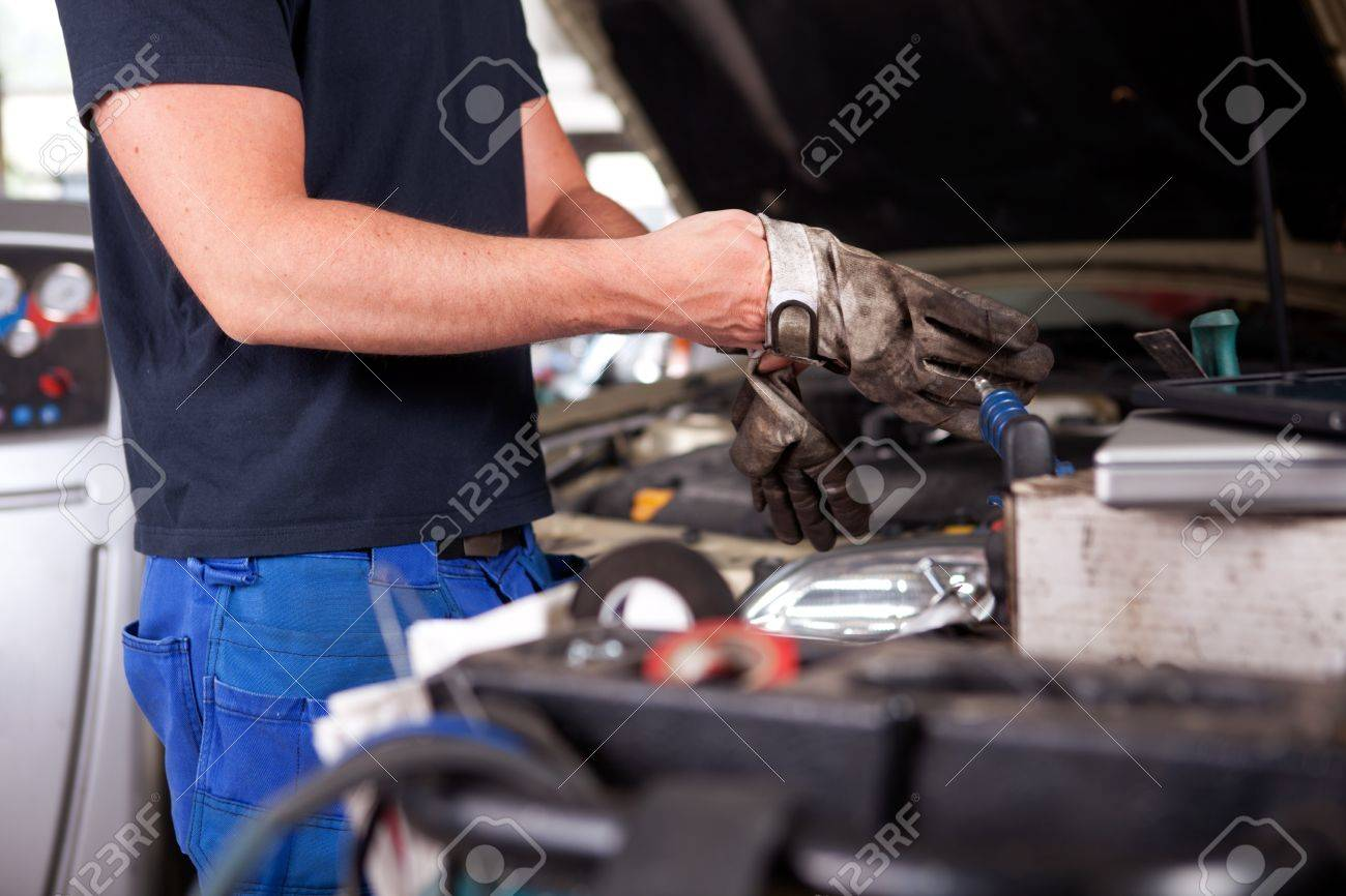 Detail of a mechanic putting on dirty work gloves Stock Photo - 10177937