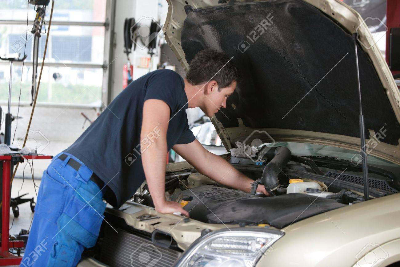 Auto mechanic working on a car in garage Stock Photo - 10451870
