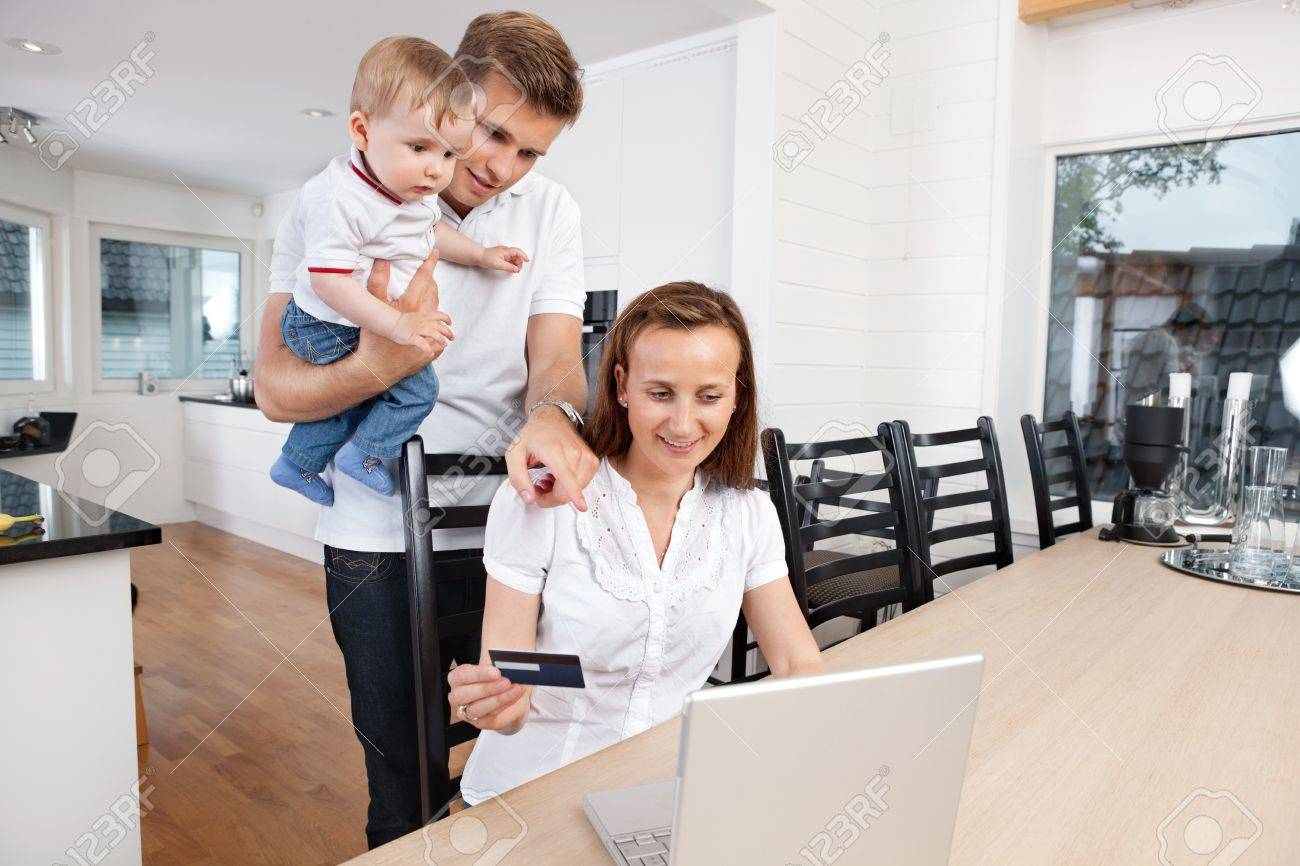 Nice Home Shopping Online Part - 7: Family Shopping Online At Home Stock Photo - 10723130