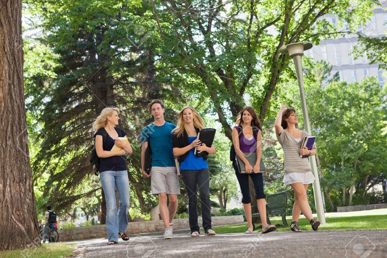 University Students Walking Through The Park On Their Way To.. Stock Photo,  Picture And Royalty Free Image. Image 10762617.