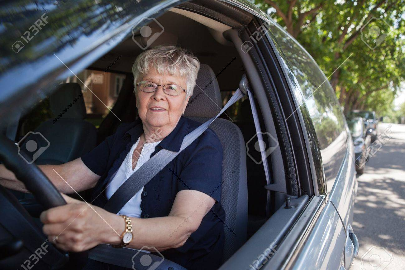 Portrait Of Smiling Old Woman Driving Car Stock Photo, Picture And ...