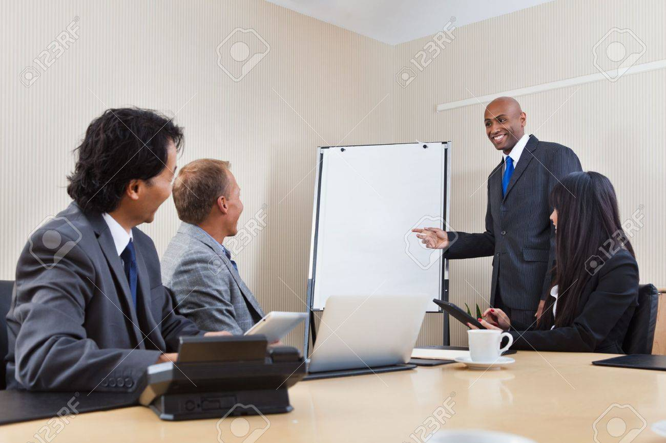 An African American business man giving a presentation to associates Stock Photo - 11048179