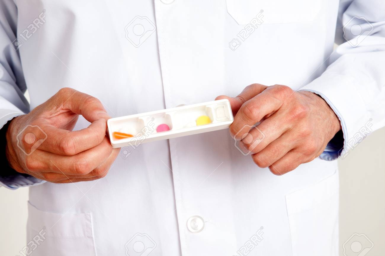 Close-up of male doctor hand holding pills Stock Photo - 12767272