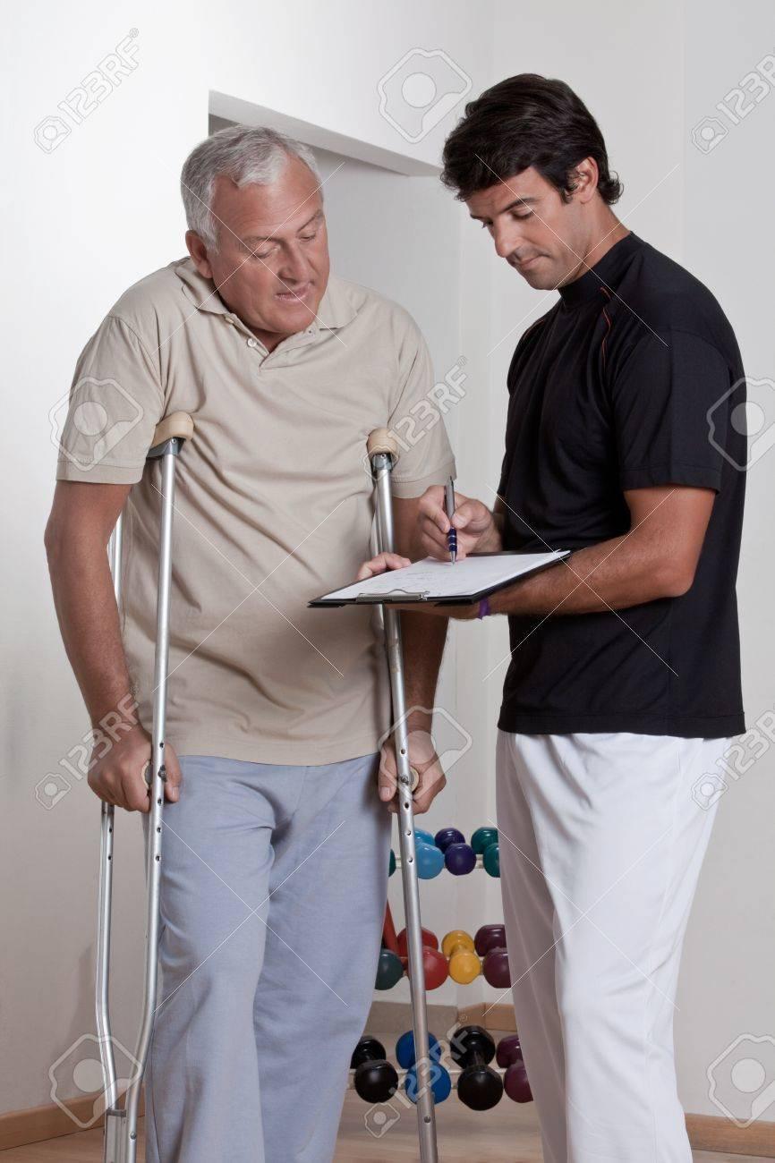 Patient on crutches discusses his progress Stock Photo - 14172329