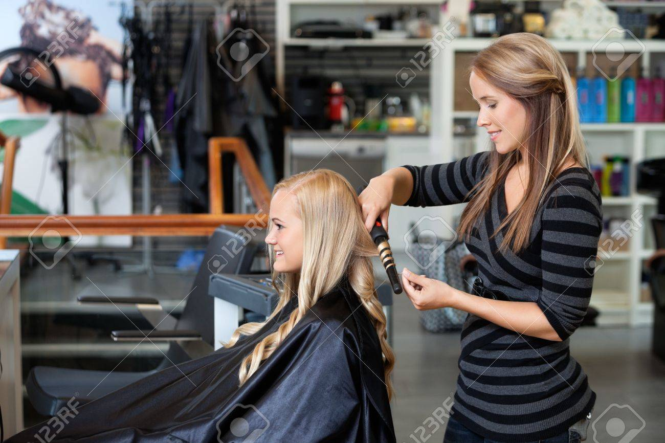 Side View Of Young Stylist Curling Woman S Hair Giving A New Stock Photo Picture And Royalty Free Image Image 14838423