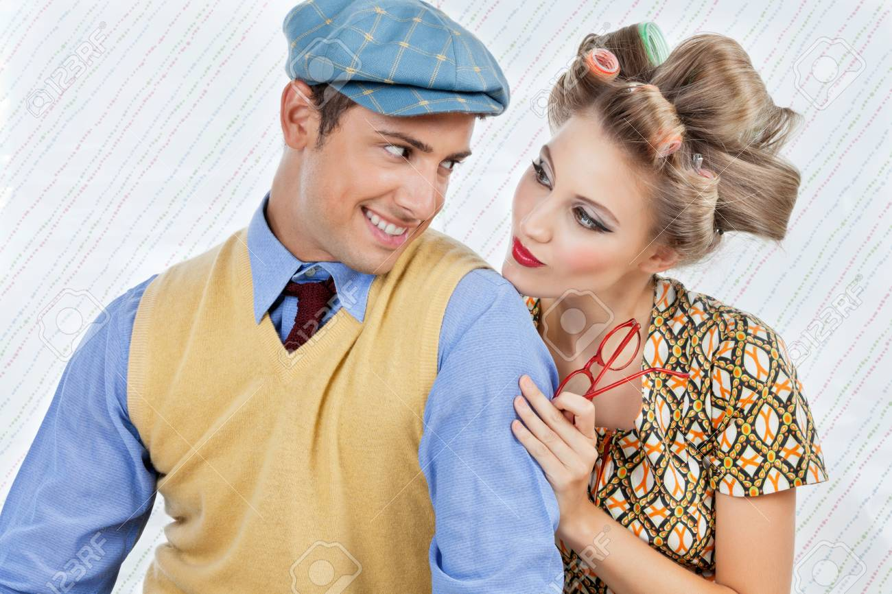 Retro styled young couple looking at each other over textured background Stock Photo - 15190815