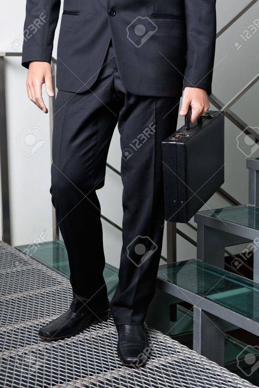 Businessman With Briefcase Standing By Steps Stock Photo - 16470599