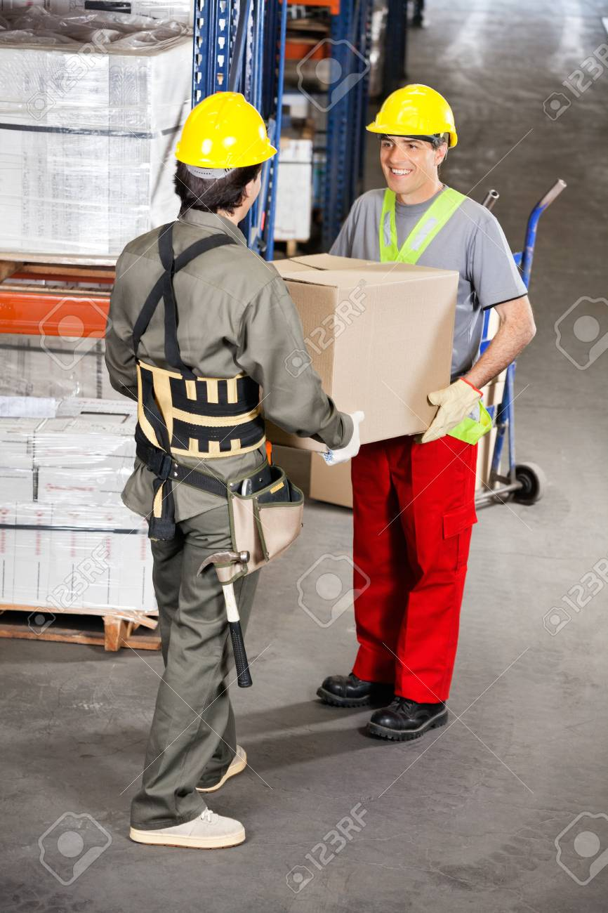 Foremen Carrying Cardboard Box At Warehouse Stock Photo - 16489838