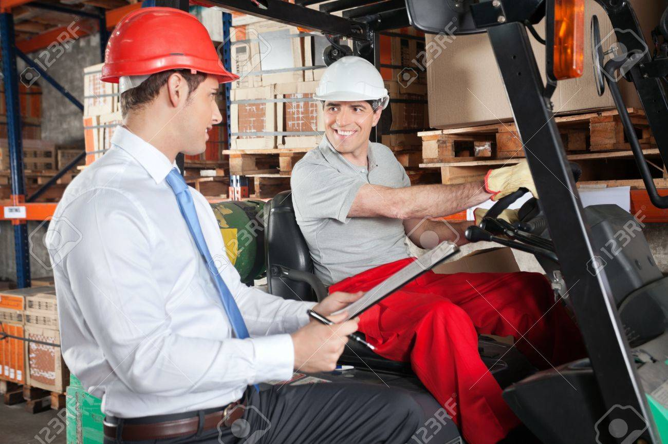 Forklift Driver Communicating With Supervisor Stock Photo - 16489831