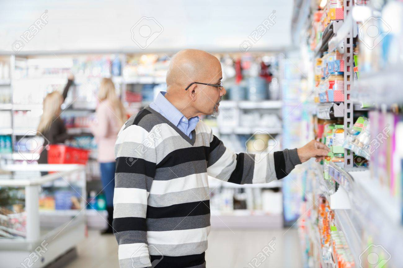 Mature Man Shopping In A Supermarket Stock Photo - 16660095