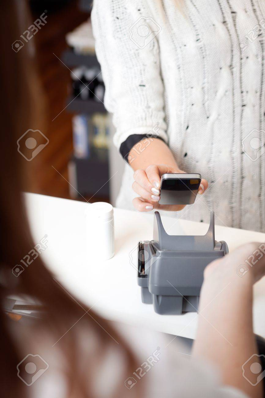 NFC Payment Using Mobile Phone Stock Photo - 16660099