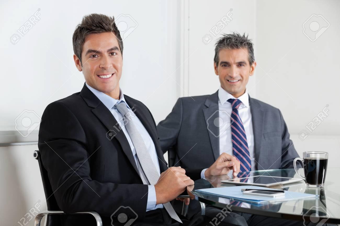 Businessmen Using Digital Tablet In Office Stock Photo - 16672669