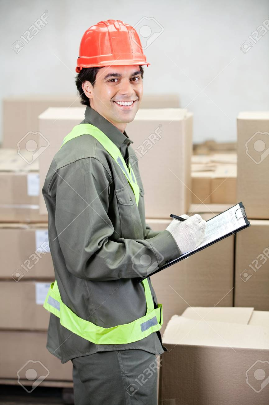 Supervisor Writing Notes At Warehouse Stock Photo - 16672692