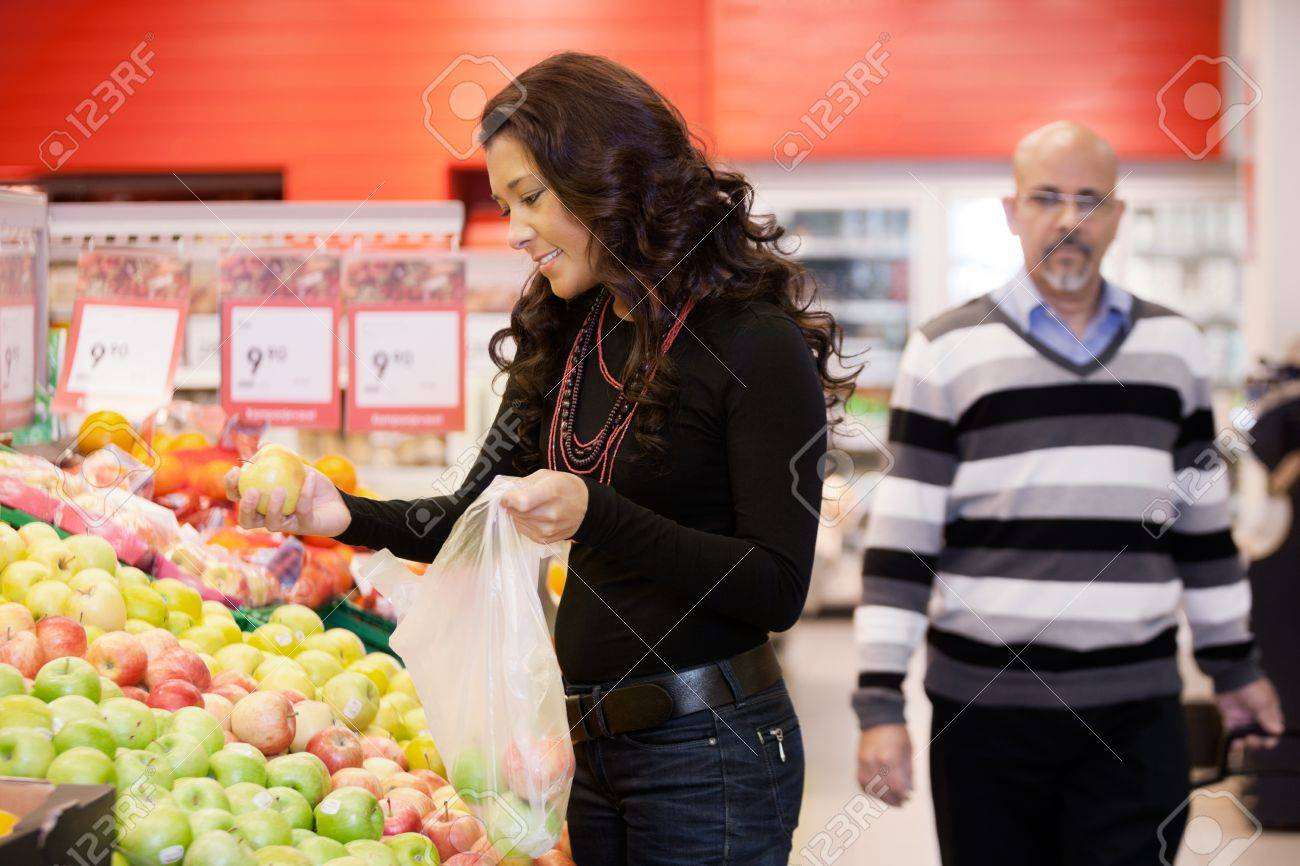 Mid Adult Woman Buying Fruit At Supermarket Stock Photo - 16672684