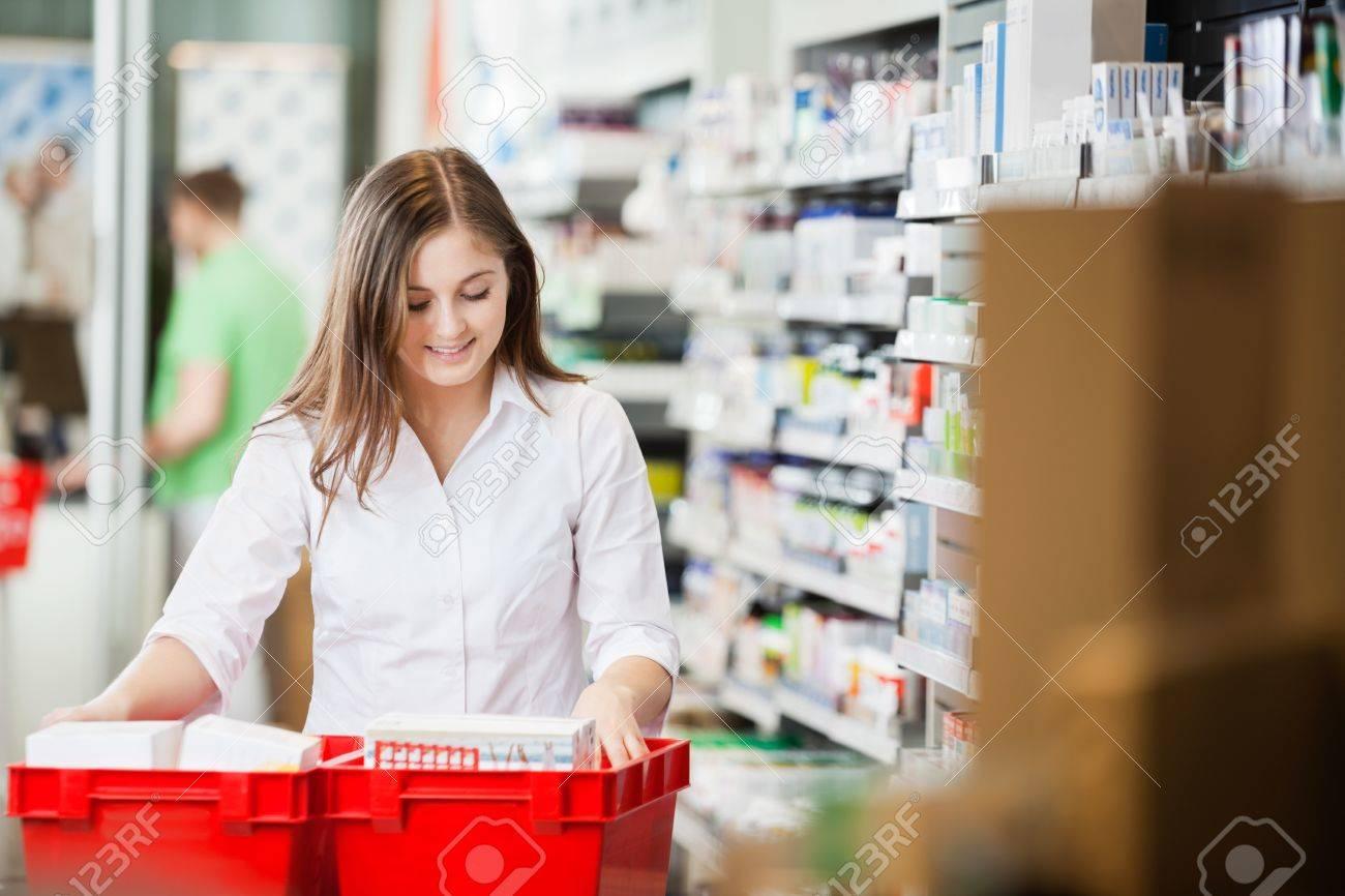 Pharmacist Stocking Shelves in Pharmacy - 16672670