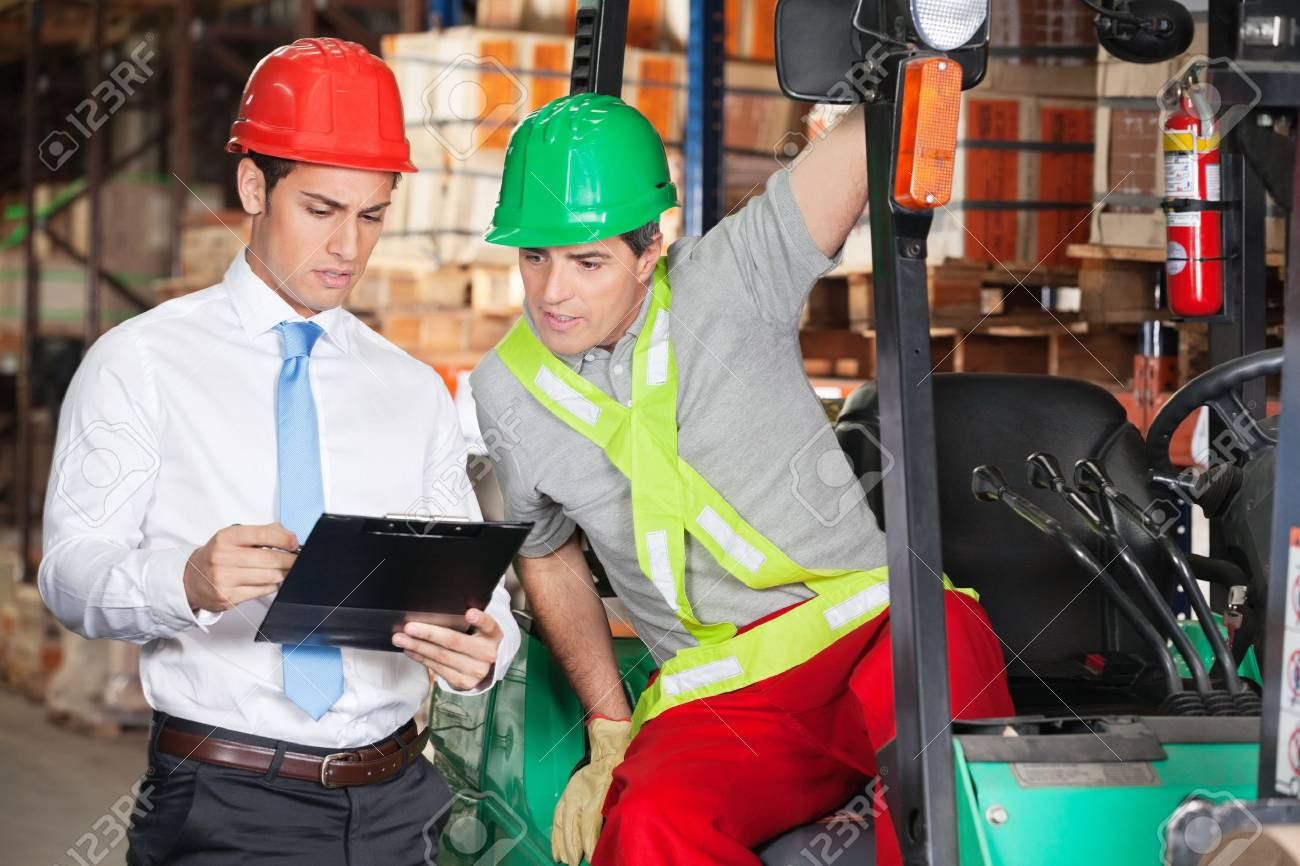 Supervisor Showing Clipboard To Forklift Driver Stock Photo - 16715212