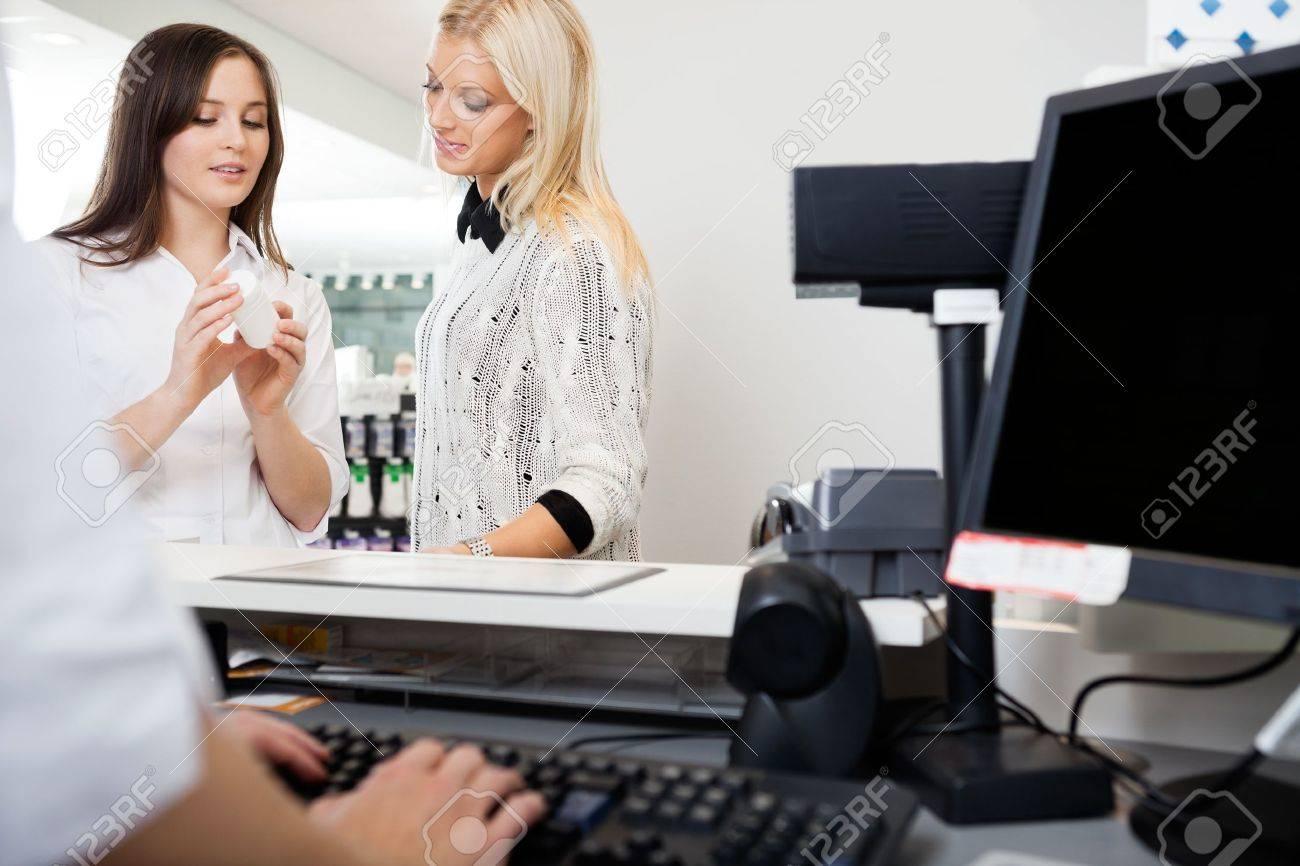 s clerk assisting w in pharmacy stock photo picture and s clerk assisting w in pharmacy stock photo 16715250