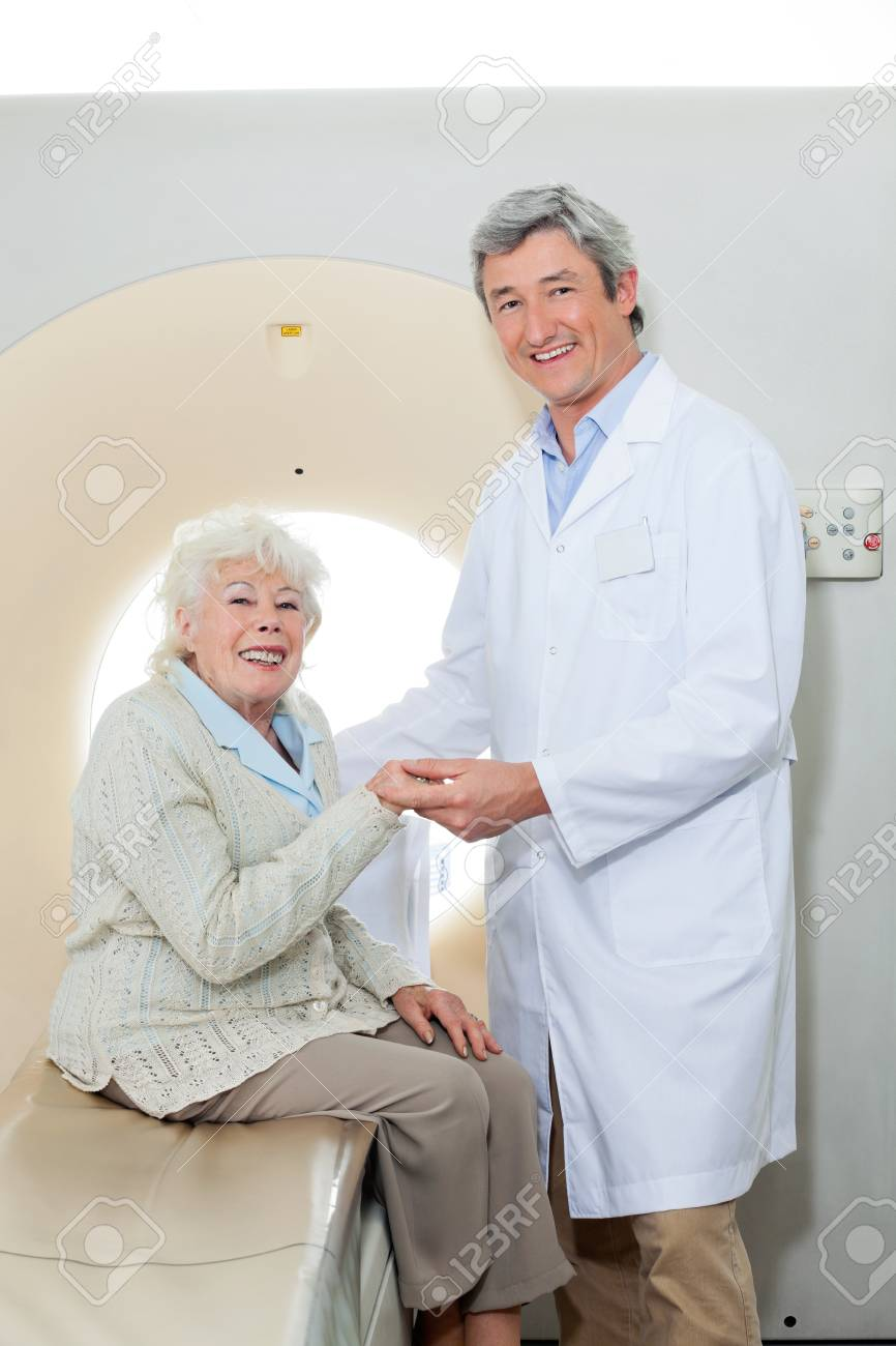 Happy Doctor And Female Patient Stock Photo - 17167088