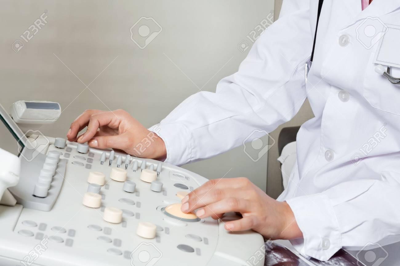 Female Radiologist Operating Ultrasound Machine Stock Photo - 17185898