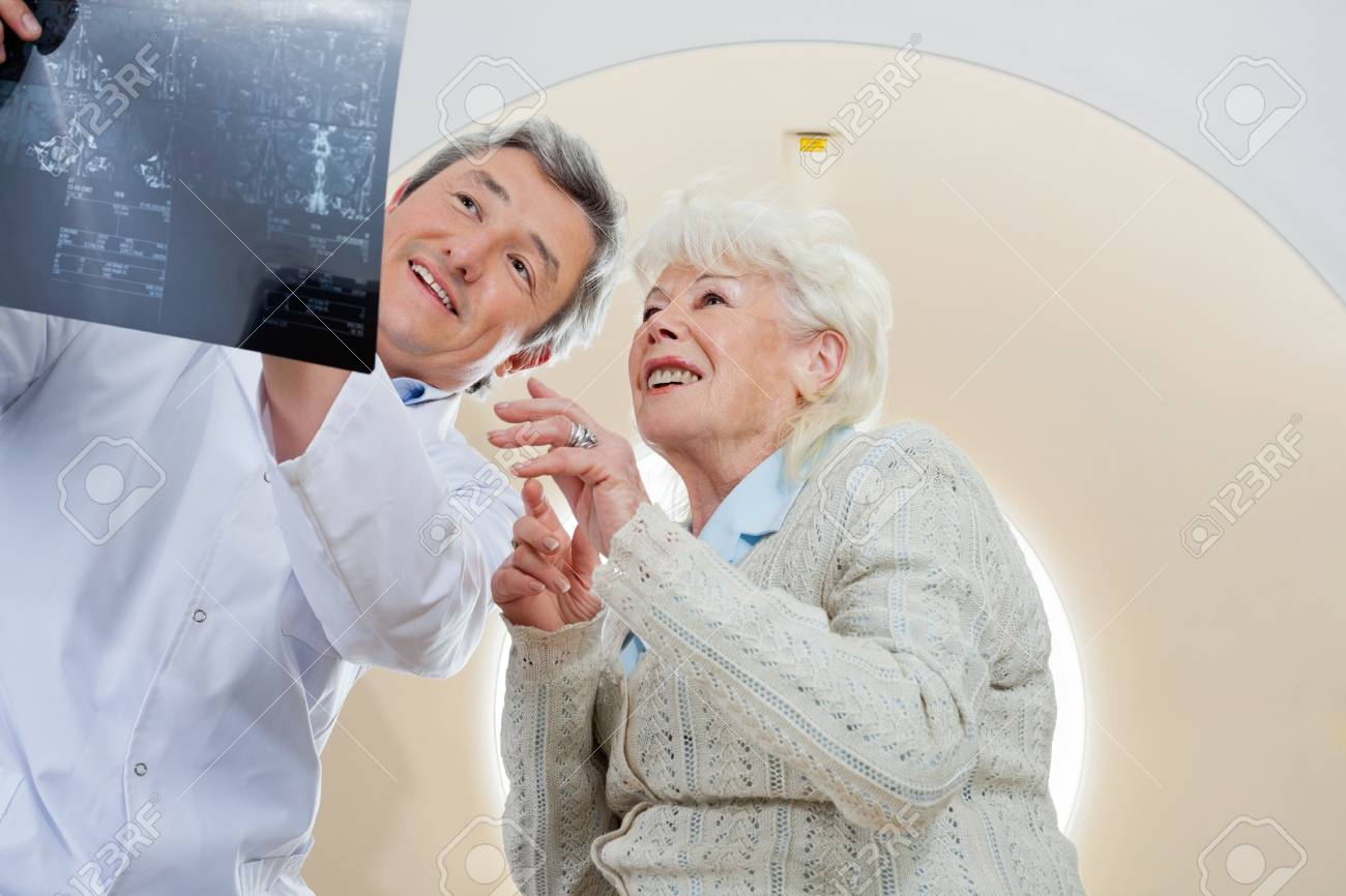Doctor With Patient Looking At MRI X-ray Stock Photo - 17238660