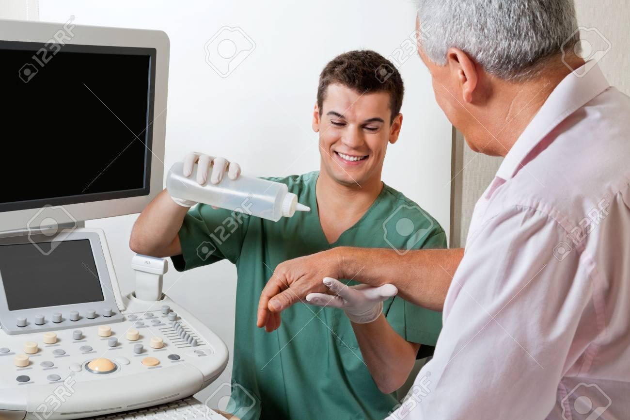 Technician Putting Gel On Patient s Hand Stock Photo - 17238694