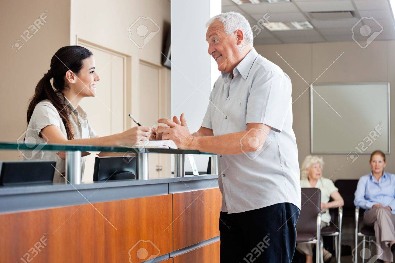 Man Communicating With Female Receptionist Stock Photo - 17238668