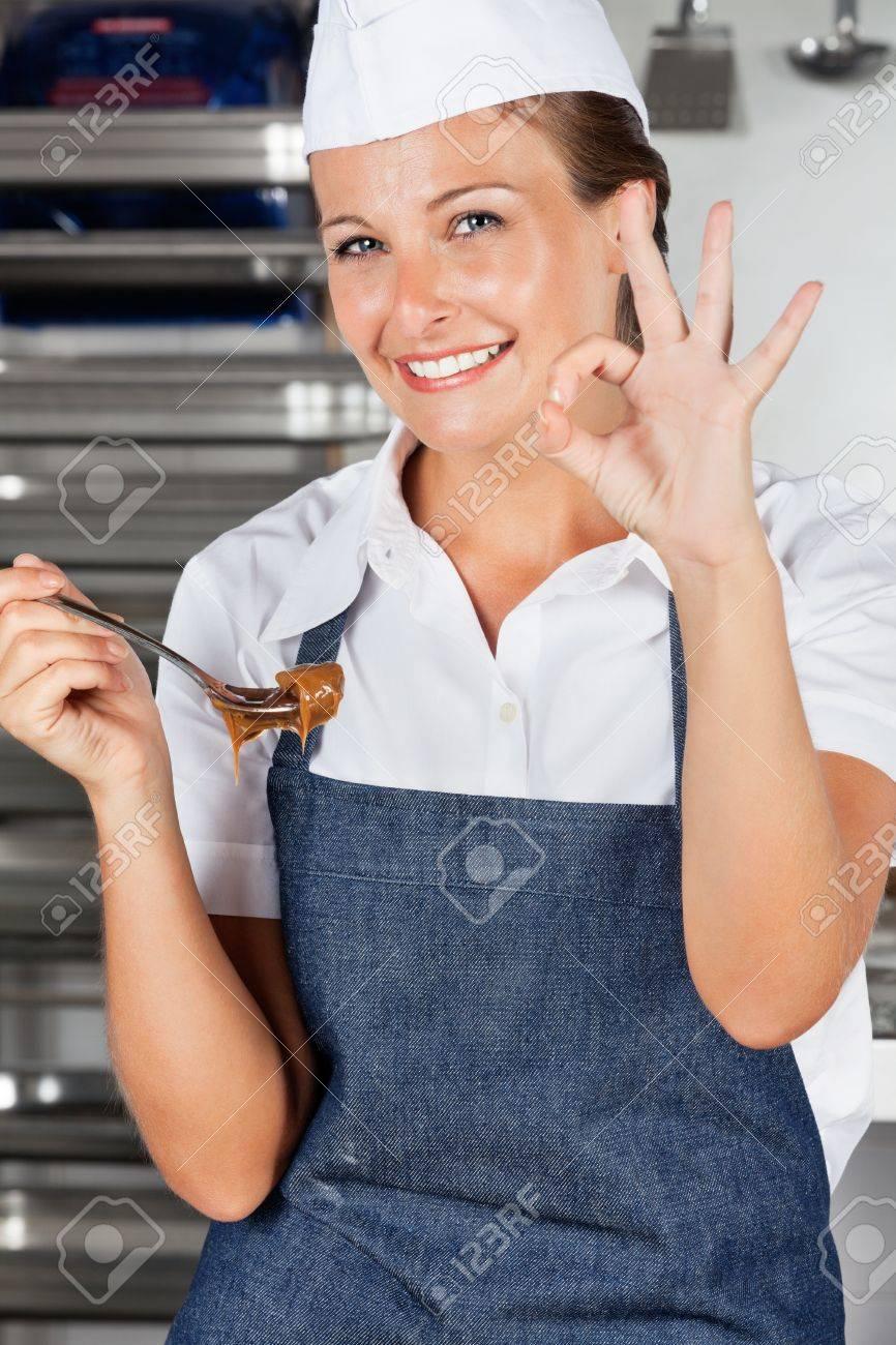 Female Chef Appreciating Delicious Chocolate Stock Photo - 18029424