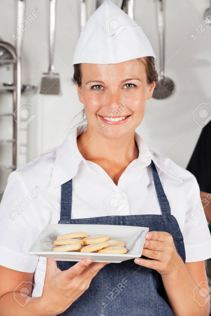 Happy Female Chef Presenting Cookies Stock Photo - 18029442