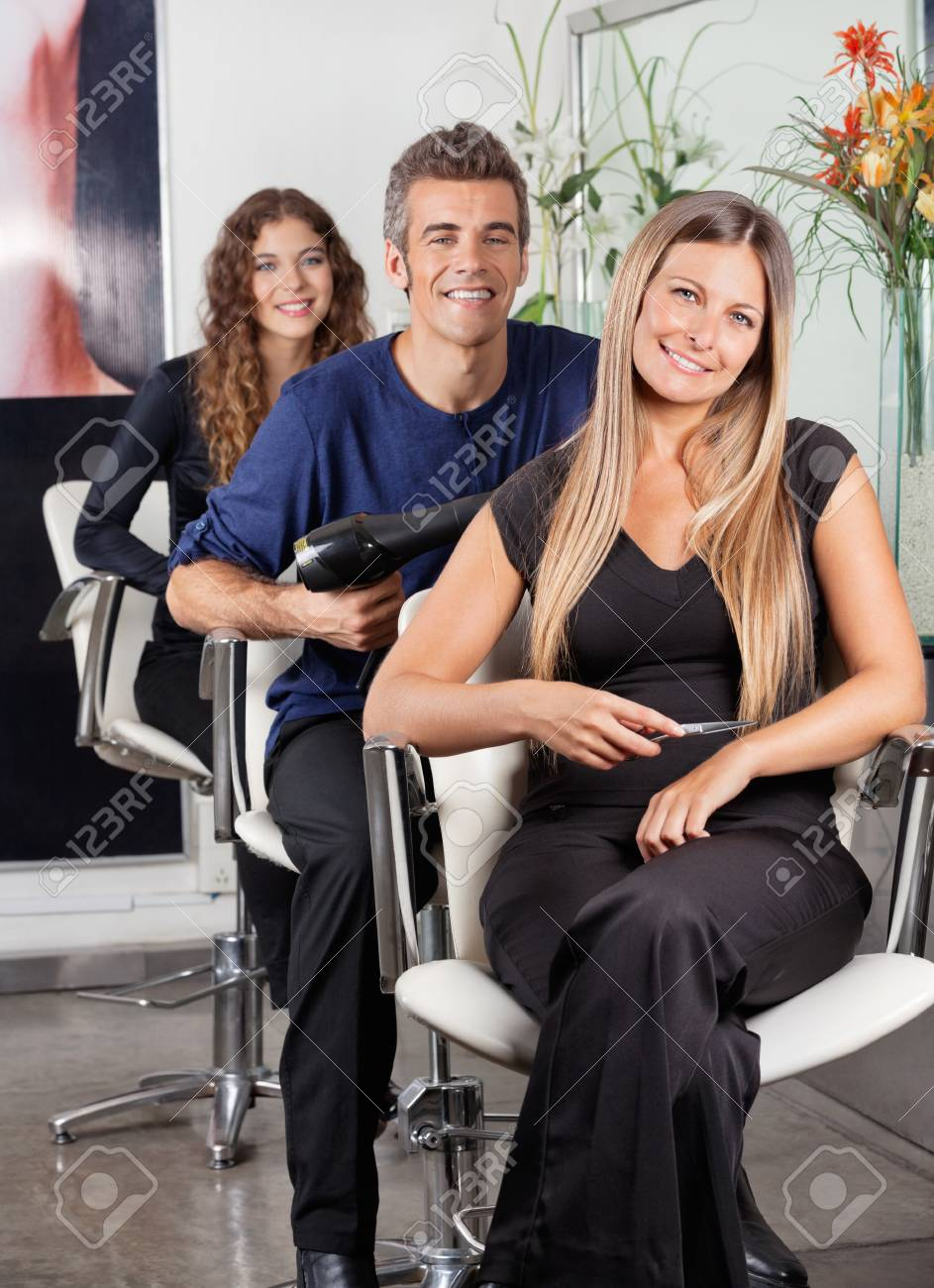 Confident Team Of Hairstylists At Beauty Parlor Stock Photo - 18068551