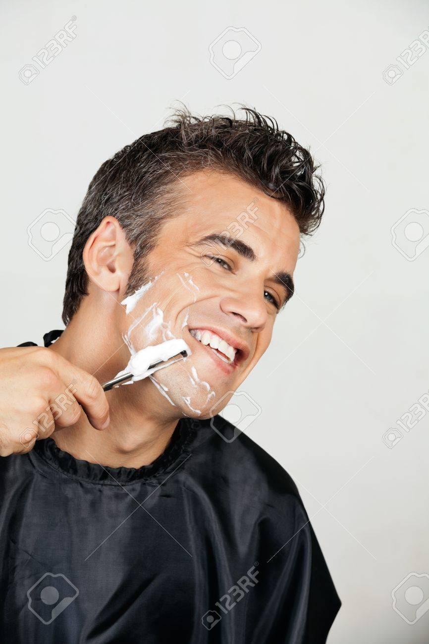 Happy Man Shaving His Face Stock Photo - 18068544