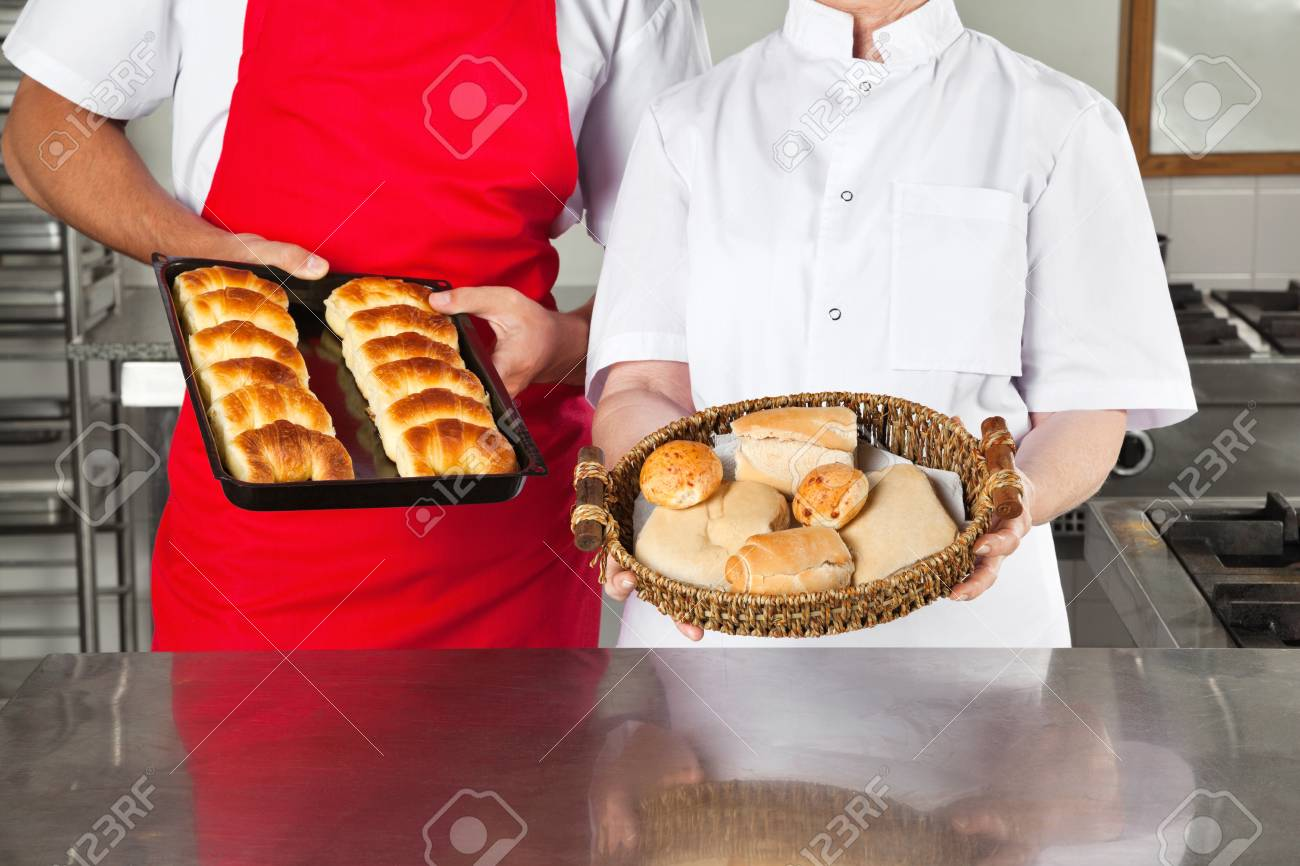 Chefs Holding Baked Breads In kitchen Stock Photo - 18091662