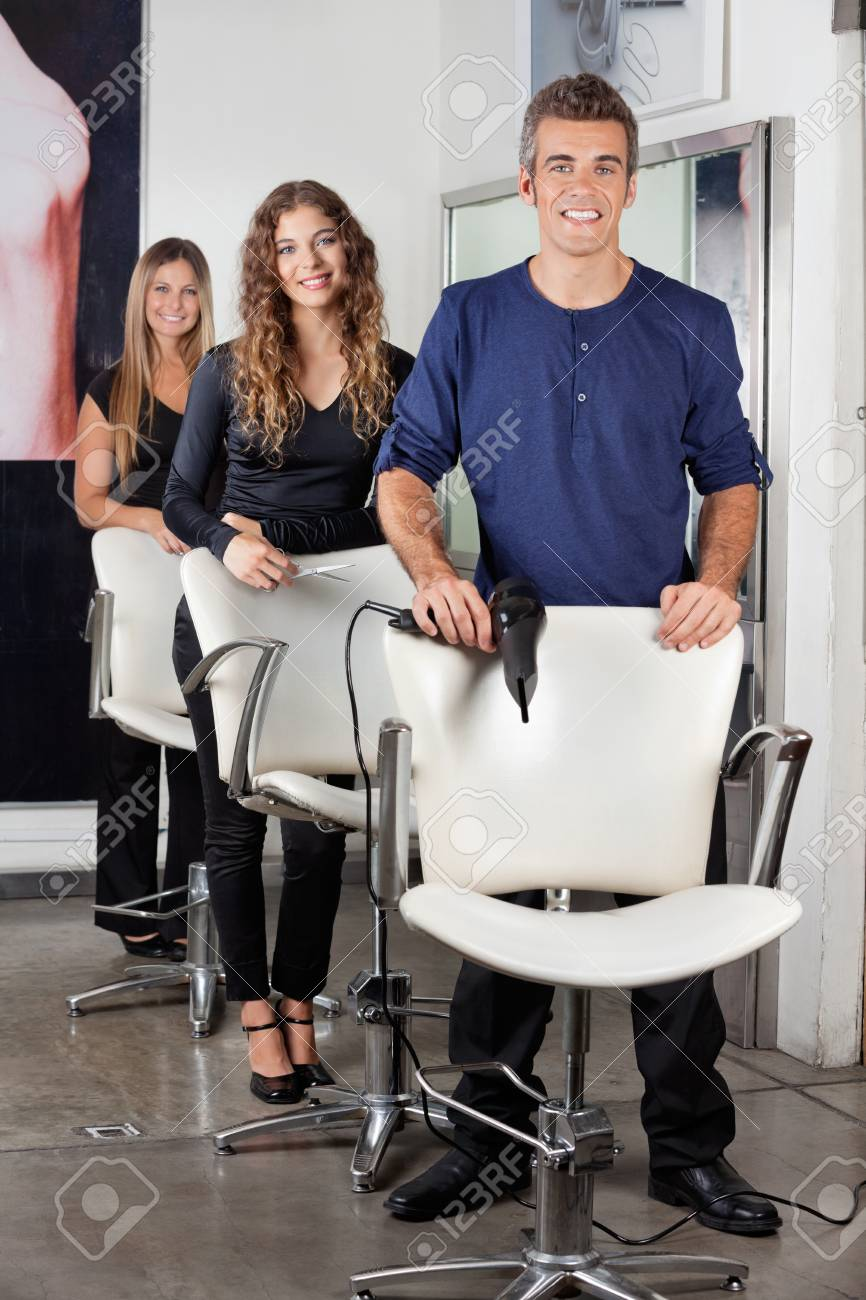 Hairdressers Standing In Salon Stock Photo - 18261887