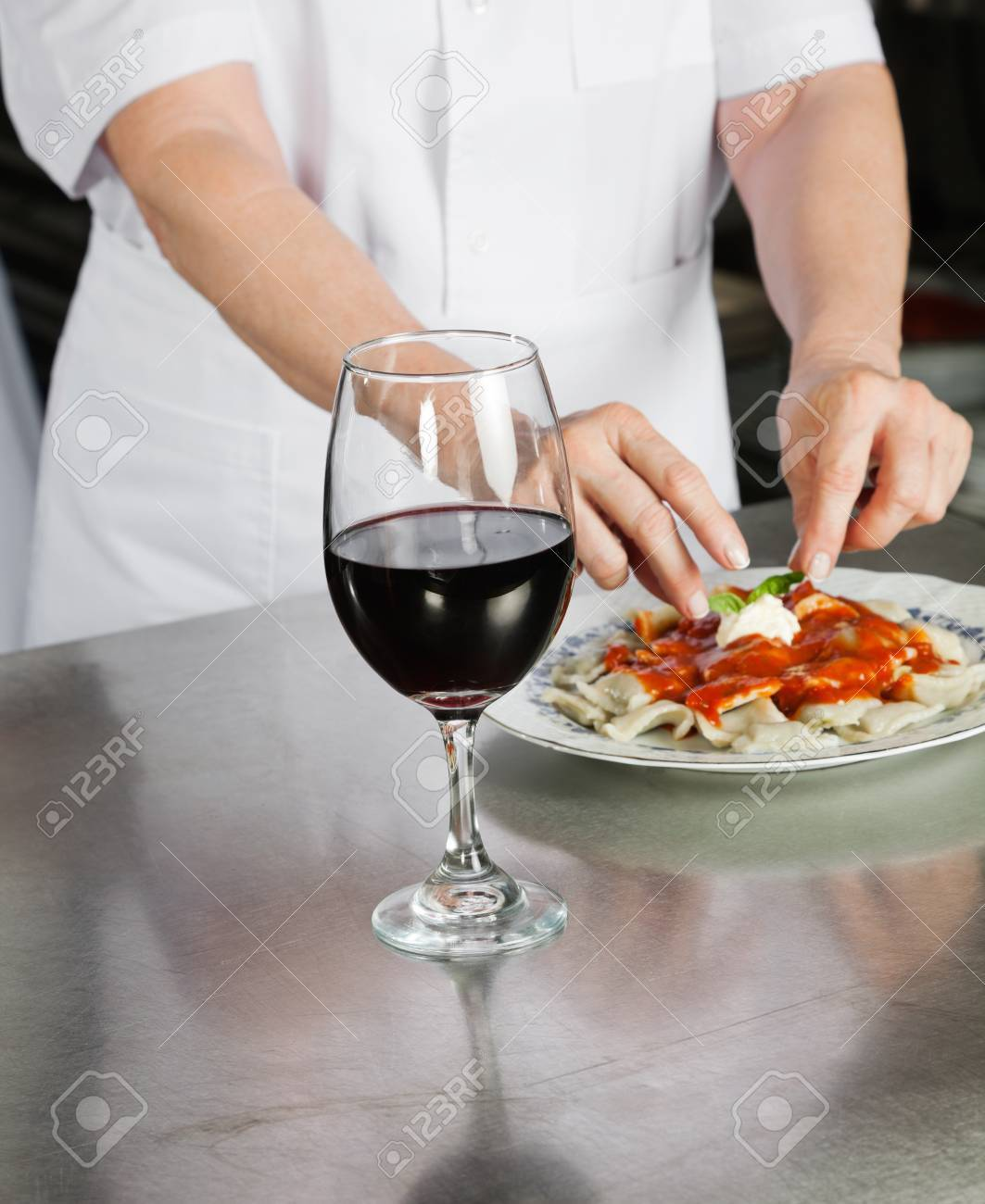 Male Chef Garnishing Pasta Dish Stock Photo - 18355811