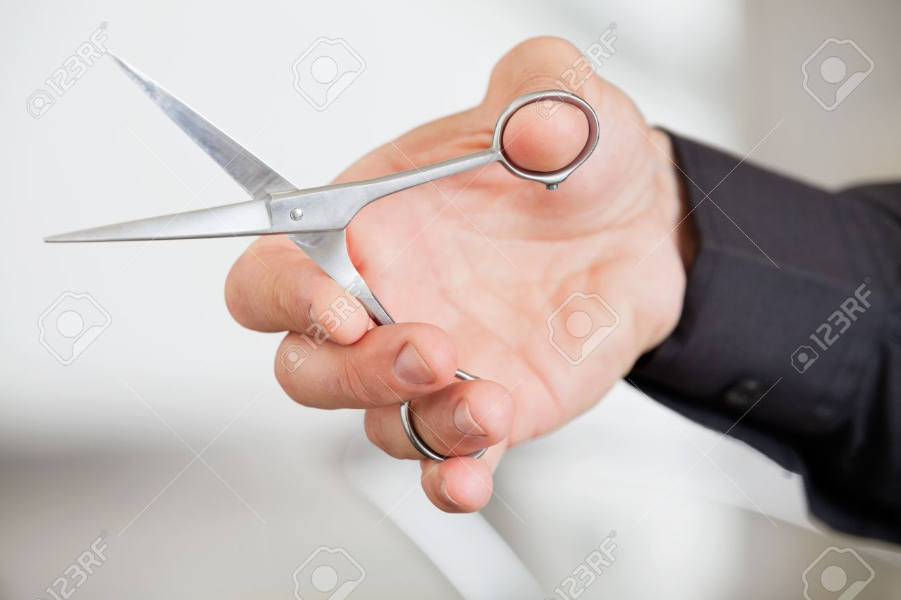 Male Hairdresser s Hand Holding Scissors Stock Photo - 18414198