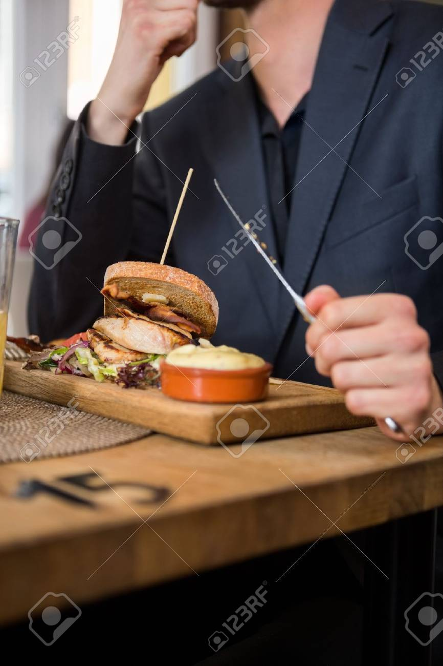 Businessman Eating Food In Restaurant Stock Photo - 19938070