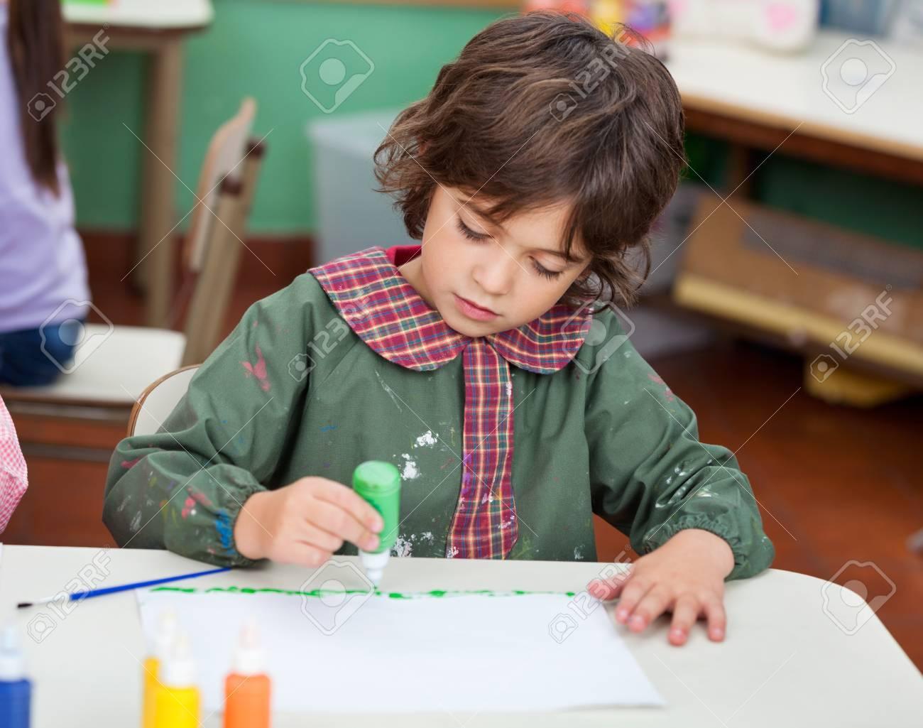 Little Boy Drawing In Art Class Stock Photo - 19938048