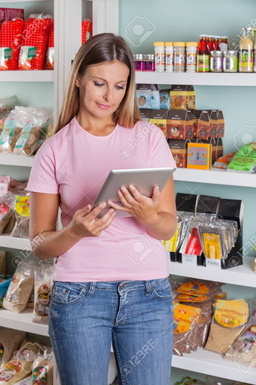 Woman Using Digital Tablet In Supermarket Stock Photo - 20419379