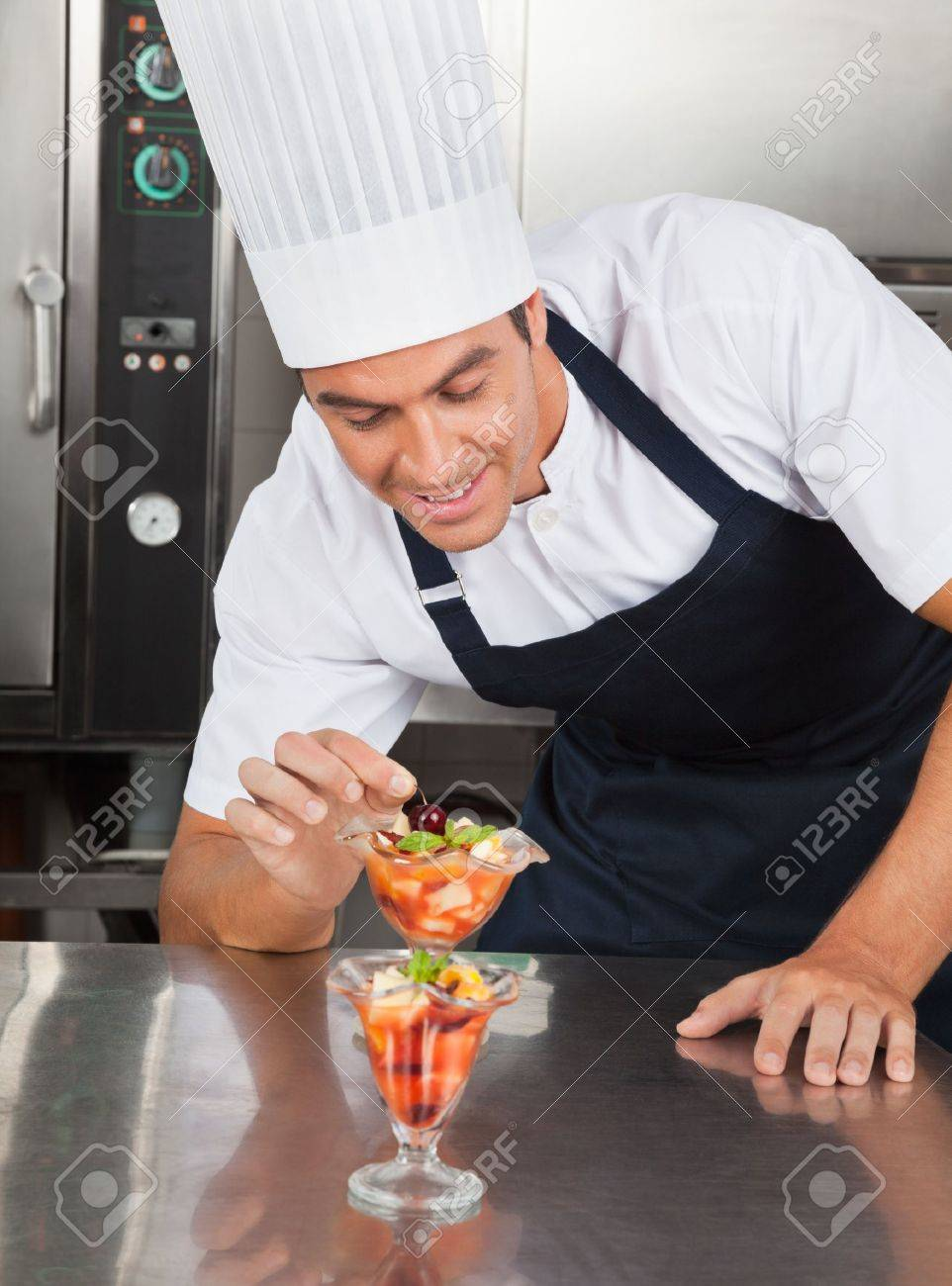 Young Chef Decorating Delicious Dessert Stock Photo - 21219990