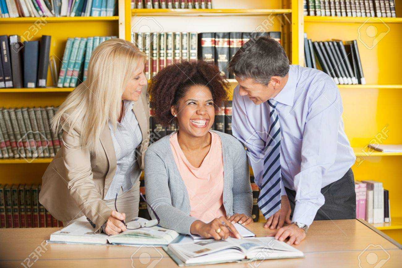 Cheerful College Student With Teachers In University Library Stock ...