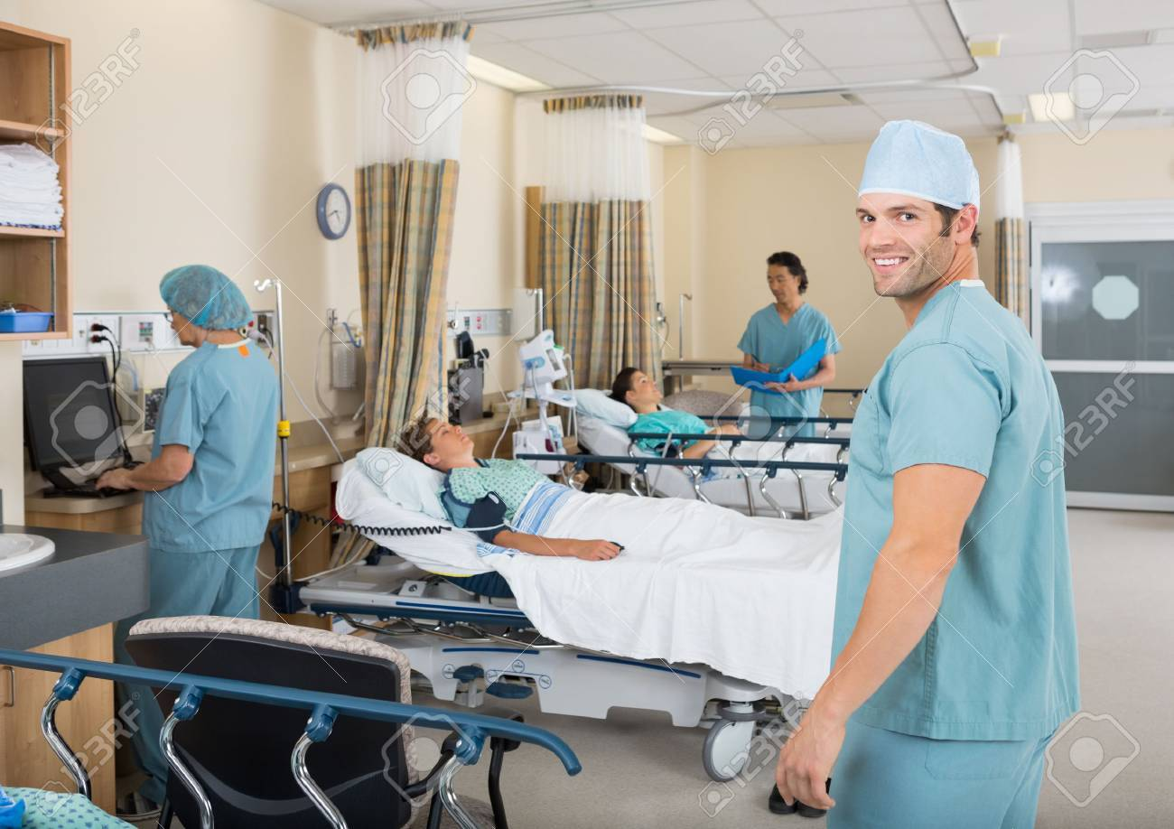 Portrait of young male nurse standing in hospital PAR unit Stock Photo - 25762172