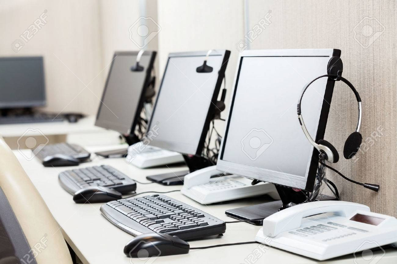 related deskoffice computers with headphones on desk