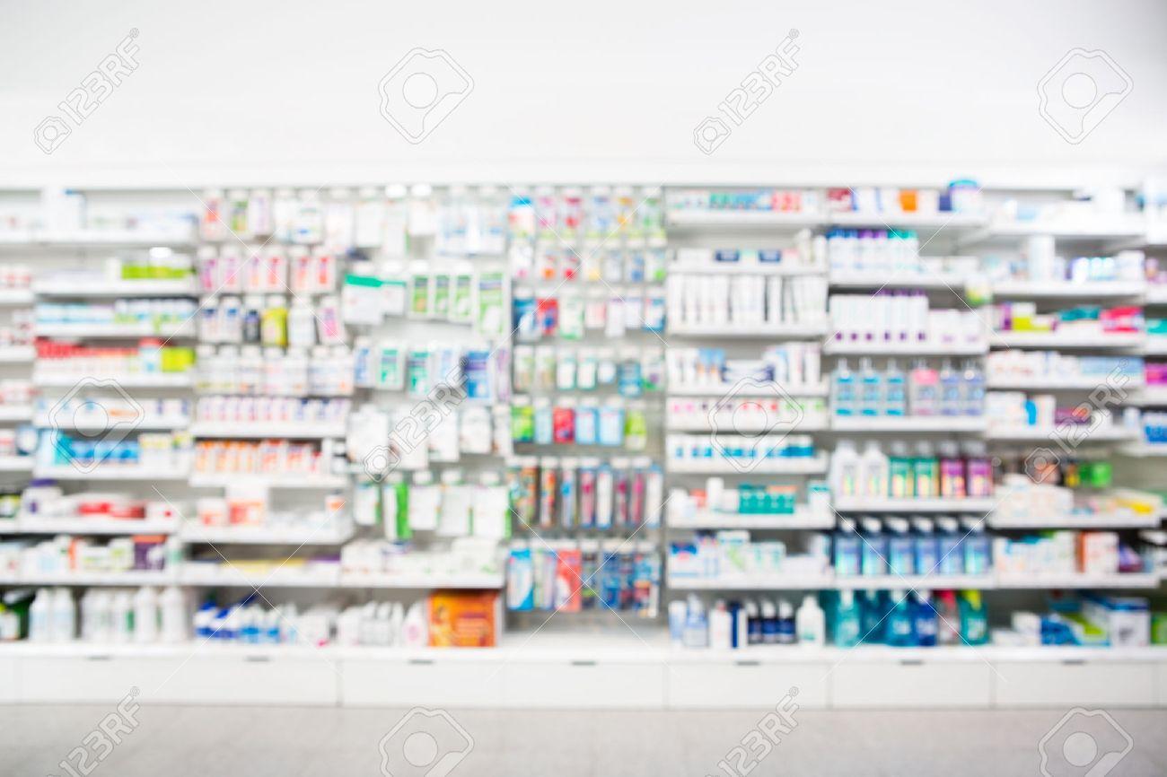 Defocused image of medicines arranged in shelves at pharmacy - 53313442